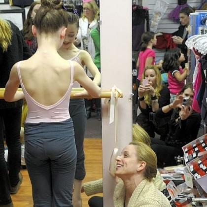 Pittsburgh Ballet School principal Anastasia Wovchko helps fit one of her students, Gianna Christensen, 10, of Pine with her first pointe shoes at The Dancer's Pointe in the Strip District.