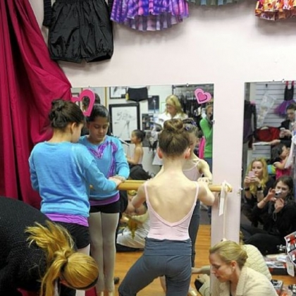 Pittsburgh Ballet School dancers Polina Giaramita, left, 10, of Wexford and Gianna Christensen, 10, of Pine, are fitted for their pointe shoes by Victoria Blackburn, far left, and Anastasia Wovchko at The Dancer's Pointe in the Strip District.