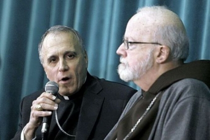 Cardinal Daniel Nicholas DiNardo, archbishop of Galveston-Houston, left, and Cardinal Sean Patrick O&#039;Malley, archbishop of Boston, attend a news conference Tuesday at the Pontifical North American College in Rome.