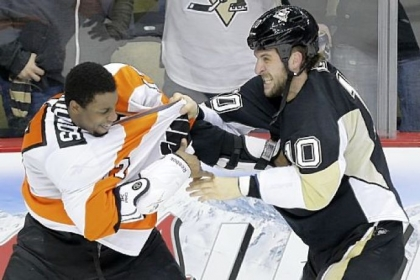 Tanner Glass fights with Philadelphia Flyers right wing Wayne Simmonds during a Feb. 20 game. The two teams meet again tonight in Philadelphia.