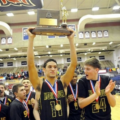 Montour's Devin Wilson holds the trophy after defeating Chartiers Valley in the WPIAL Class AAA championship last Friday night.