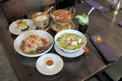 At Nicky's Thai Kitchen, Downtown, you'll find (clockwise from front): sauce for sukiyaki noodle soup. papaya noodle salad with mussels, taro coconut dessert, coconut jasmine rice, hung ley curry, green ice tea, and sukiyaki noodle soup.