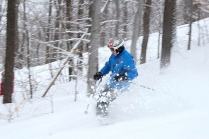 Skier John Denard enjoys a fresh powder run on Hidden Valley Resort&#039;s Cobra Glades Wednesday morning.