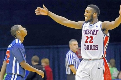 Robert Morris'' Lucky Jones celebrates near the end of his team''s win against St. Francis Wednesday night.