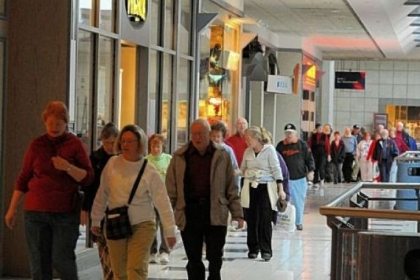 People walk the upper-level of the Westmoreland Mall  To walk the upper and lower levels equal one mile.