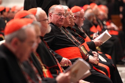 Archbishop of New York, Cardinal Timothy Dolan, center, attends a meeting of prayer Wednesday at St. Peter's Basilica with cardinals gathered for the conlave in Vatican City.