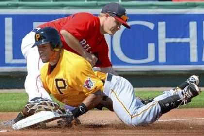 Starling Marte slides safely into third Wednesday, avoiding a tag from Boston's Brock Holt in the PIrates' 9-3 win in Fort Myers, Fla.