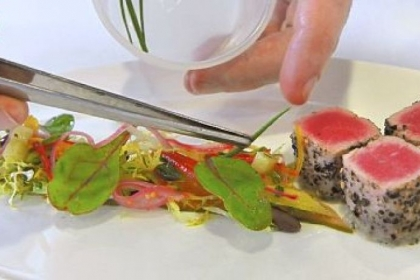 Chef Shawn Culp, of The Art Institute of Pittsburgh, plates his fancy Tuna, Palermo Style.