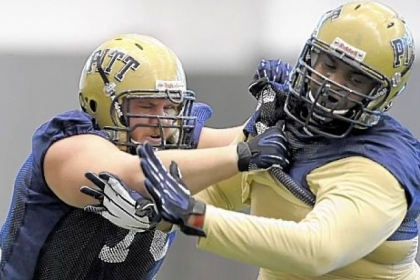 Pitt's Cory King, left, and Shane Johnson participate in spring football drills Tuesday afternoon on the South Side.