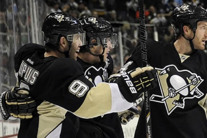 Penguins defenseman Brooks Orpik, right, sporting his distinct no-visor look, congratulates Sidney Crosby along with Pascal Dupuis in a game last month.