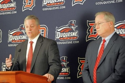 Duquesne athletic director Greg Amodio, left, will have to navigate the realignment uncertainty that surrounds college basketball.