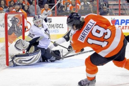 Penguins goaltender Tomas Vokoun, left, in as a mid-game replacement for Marc-Andre Fleury, makes a save on a shot by the Flyers' Scott Hartnell in the second period Thursday in Philadelphia. The Penguins came back from an early deficit to win, 5-4.