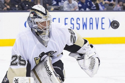 The Penguins' goaltender Marc-Andre Fleury makes a save in the second period.
