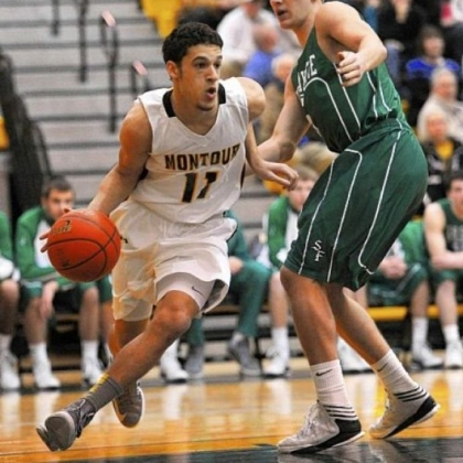 Montour Devin Wilson drives around South Fayette's Justin Watson in a PIAA Class AAA first-round game Friday night at North Allegheny.