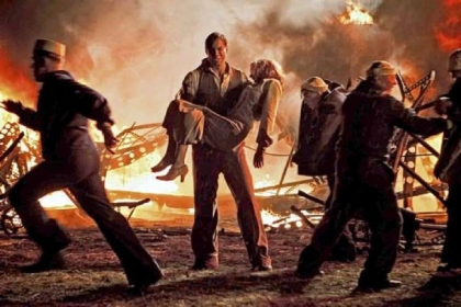 "Maximilian Simonischek carries Lauren Lee Smith away from the Hindenburg crash in the miniseries ""Hindenburg: The Last Flight,"" airing at 8 p.m. Monday and Tuesday on Encore."