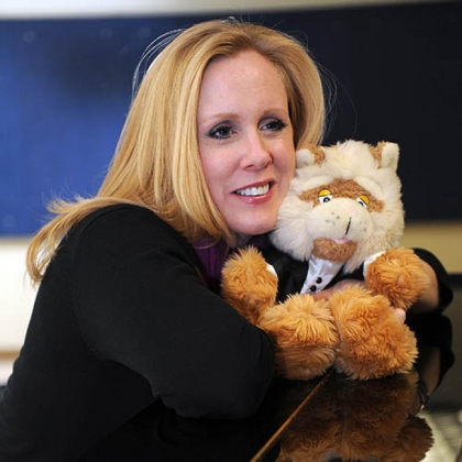 Soprano Katy Williams cuddles Fiddlesticks the Cat, her singing partner in the PSO's children's concerts.