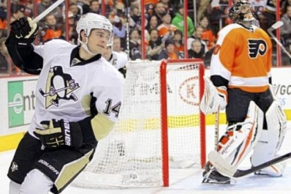 Chris Kunitz reacts after scoring against Philadelphia Flyers goalie Ilya Bryzgalov in the first period of the Penguins&#039; 5-4 win Thursday, March 7.