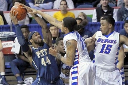 J.J. Moore, left, is pressured by DePaul's Jamee Crockett in the second half of what was a perfect shooting game for Moore in Pitt's win in Rosemont, Ill.
