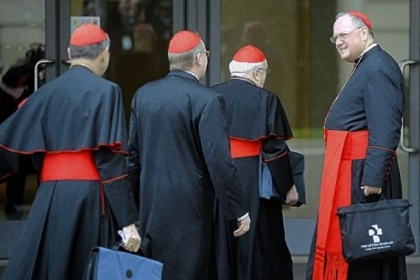 Cardinal Timothy M. Dolan, archbishop of New York, right, arrives Saturday for a pre-conclave meeting at the Vatican.