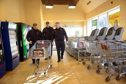 From left, firefighters Kevin Murphy and Dan Reiser and Lt. John Gardell enter a Giant Eagle to buy items for the day's meals. Three minutes into shopping, the three receive a call for sparking wires near a residence and leave the store.