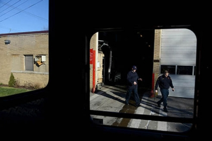 Firefighter Dan Reiser, left, and Lieutenant John Gardell exit Fire Station 17 in Homewood in order to make a trip to the grocery store for lunch on Friday, Jan. 18, 2013.