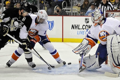 Chris Kunitz gets around the Islanders' Lubomir Visnovsky to score on goaltender Evgeni Nabokov for his first goal in the first period.