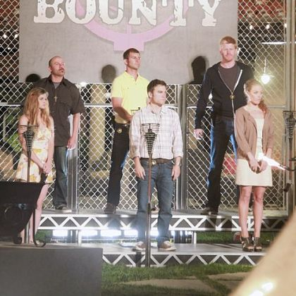 Chase Rogan (top row center w/yellow shirt), believes he is taking part in an elimination ceremony for a new reality tv series seaching for American's next bounty hunter.