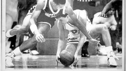Pitt guard Sean Miller, right, grabs a loose ball from Georgetown's Sam Jefferson in a game Feb. 20, 1988 in Pittsburgh. Pitt defeated Georgetown, 70-65, in a game that was called off with 4 seconds on the clock because officials could not control the game.