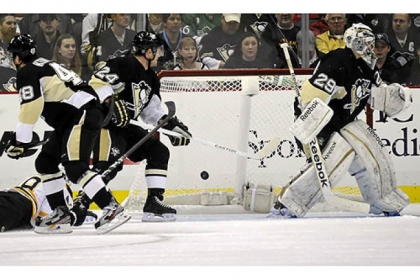 The Bruins' Tyler Seguin, bottom left, scores on Penguins goaltender Marc-Andre Fleury in the first period at Consol Energy Center.