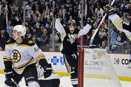 The Penguins' Brandon Sutter celebrates his winning goal against the Bruins in the third period at Consol Energy Center.