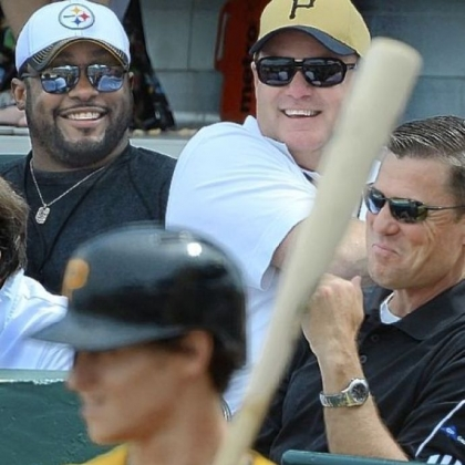 Steelers coach Mike Tomlin and general manager Kevin Colbert joke with Pirates president Frank Coonelly at a Pirates exhibition game at McKechnie Field in Bradenton, Fla.