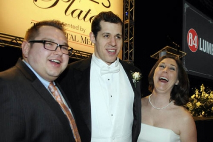 Jeff and Samantha Hollack flank Evgeni Malkin.