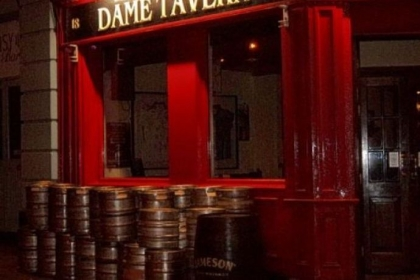 At closing time in Dublin&#039;s touristy Temple Bar region, a day&#039;s worth of empty kegs are piled outside a pub.