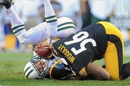 Steelers linebacker LaMarr Woodley sacks Jets quarterback Mark Sanchez during a game last season.