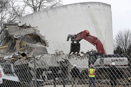 Demolition of the Gettysburg Cyclorama building continues Monday in Gettysburg, Pa. Contractors are being careful not to damage the historical trees in the area during the demolition.