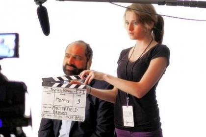 Franco Harris being interviewed in January 2012 for the Joe Paterno movie, &quot;The Joe We Know.&quot; About 70 former Penn State football players had their memories of  Paterno taped for the film. At right is Grace Leri, who helped in the production.