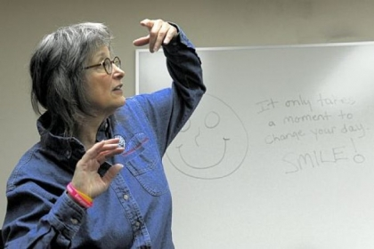 Julie Ann Sullivan during a laughter workshop last month at the Volunteers of America office in Sharpsburg: &quot;It is phenomenal to teach people to create their own true, mirthful laughter.&quot;