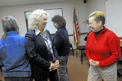 Marty Stahl, left, of Squirrel Hill and Sharon Janitor of Etna take part in a laughter workshop led by Julie Ann Sullivan at the Volunteers of America office in Sharpsburg.