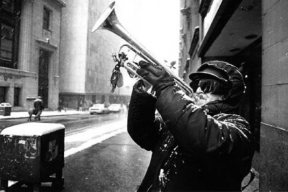 Falco Sciulli of Greenfield plays the trumpet at the corner of Fifth Avenue and Grant Street as the March 13, 1993 St. Patrick's Day Parade goes by.