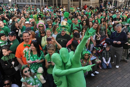 Spectators get their green on at last year&#039;s St. Patrick&#039;s Day Parade Downtown.