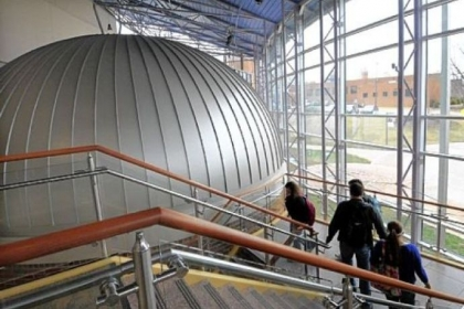 Students walk past the dome of the Angelo Taiani Planetarium in the Dupre Science Pavilion.