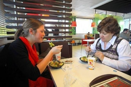 Aimie Zvosec of Chicago, left, and Dina Phillip of Naperville dine on salads from the McDonald&#039;s dollar menu last month in Oak Brook, Ill. McDonald&#039;s will be introducing new items for the dollar menu.