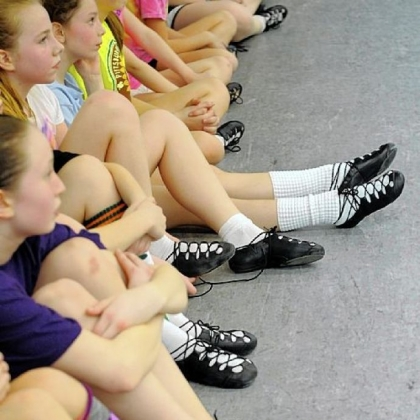 Wearing their ghillies, or soft shoes, dancers take a break from practice in the Ross studio of the Bell School of Irish Dance.