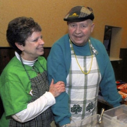 Maureen Donnelly of Heidelberg, left, kids with Mickey Abbott of Scott at the fish fry at the Ukrainian American Club in Carnegie.