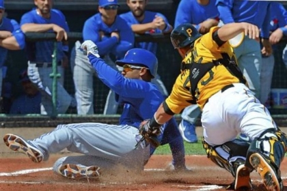 Anthony Gose of the Blue Jays slides in ahead of the tag of Pirates catcher Russell Martin Wednesday in Bradenton, Fla. The Pirates rallied to win in extra innings.
