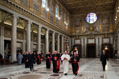 Pope Francis, flanked at left by Cardinal Agostino Vallino, and at right by Cardinal Santos Abril y Castello, walks inside St. Mary Major Basilica, in Rome today.