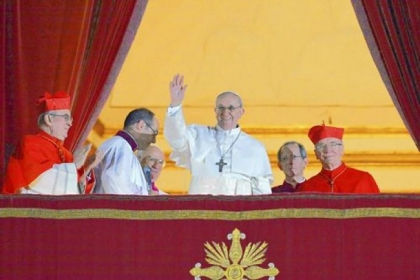 Argentina&#039;s Cardinal Jorge Bergoglio, who took the name Pope Francis, waves Wednesday from the papal balcony of St. Peter&#039;s Basilica at the Vatican after being elected the Roman Catholic Church&#039;s 266th pope.