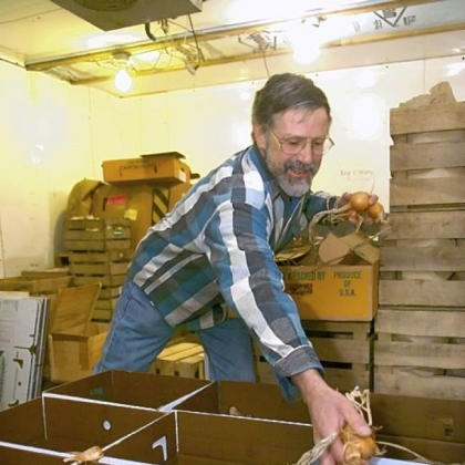 Farmer Don Kretschmann packs boxes of winter produce for delivery to customers as part of CSA.