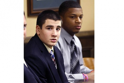 Trent Mays, 17, left, and Malik Richmond, 16, sit at the defense table.