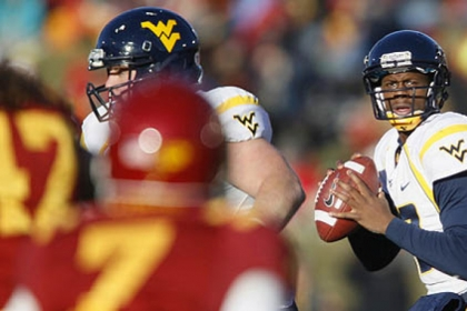 WVU quarterback Geno Smith drops back to pass during the first half of a against Iowa State last season.